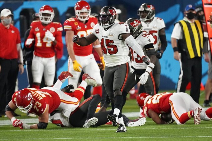 Tampa Bay Buccaneers inside linebacker Devin White celebrates after after a tackle against the Kansas City Chiefs during the first half of the NFL Super Bowl 55 football game Sunday, Feb. 7, 2021, in Tampa, Fla. (AP Photo/David J. Phillip)