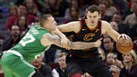 Cleveland Cavaliers' Ante Zizic, right, from Croatia, drives past Boston Celtics' Daniel Theis (27) during the first half of an NBA basketball game Tuesday, Feb. 5, 2019, in Cleveland. (AP Photo/Tony Dejak)
