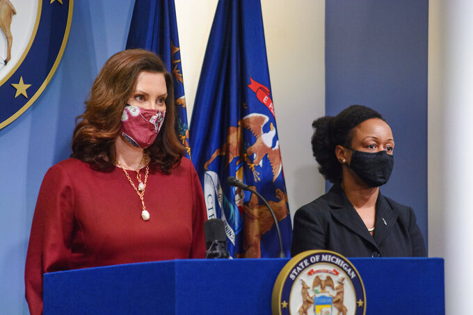 Governor Gretchen Whitmer, left, speaks as Michigan Department of Health and Human Services Chief Medical Executive, Dr. Joneigh Khaldun, listens in Lansing, Mich., Tuesday, Feb. 9, 2021. (Michigan Office of the Governor via AP)