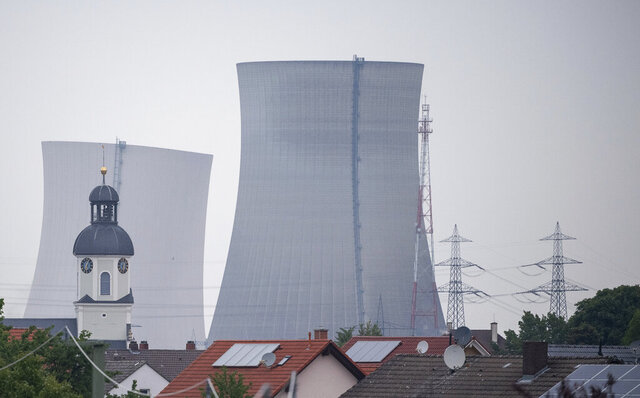 The cooling towers of the decommissioned nuclear power plant collapse after being blown up in Philippsburg, Germany, May, 14, 2020. The towers in southwestern Germany were demolished early Thursday in a pair of early-morning explosions whose timing was kept under wraps to prevent crowds from gathering during the coronavirus pandemic. (Sebastian Gollnow/dpa via AP)