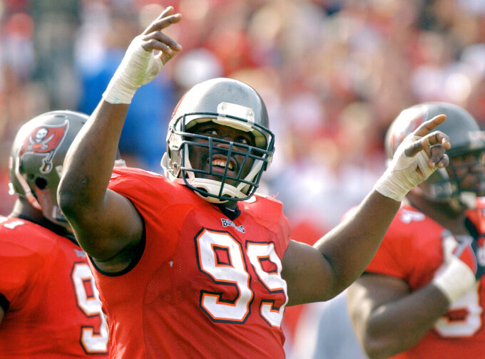 FILE - In this Jan. 12, 2003, file photo, Tampa Bay Buccaneers' Warren Sapp tries to get the crowd going during the third quarter of the team's NFC divisional NFL football playoff game against the San Francisco 49ers in Tampa, Fla. Sapp and Derrick Brooks were selected as draft picks in 1995. They formed the foundation for a defense that keyed the club's only Super Bowl championship run. (AP Photo/Steve Nesius, File)