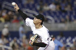 Miami Marlins starting pitcher Jordan Yamamoto throws during the first inning of the team's baseball game against the Los Angeles Dodgers, Tuesday, Aug. 13, 2019, in Miami. (AP Photo/Lynne Sladky)