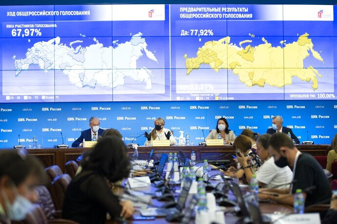 Ella Pamfilova, head of Russian Central Election Commission, wearing a face mask and gloves to protect against coronavirus, center left, gestures while speaking at a news conference in Moscow, Russia, Thursday, July 2, 2020. Almost 78% of voters in Russia have approved amendments to the country's constitution that will allow President Vladimir Putin to stay in power until 2036, Russian election officials said Thursday after all the votes were counted. Kremlin critics said the vote was rigged. (AP Photo/Alexander Zemlianichenko)