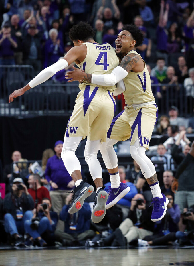 Washington's David Crisp, right, and Matisse Thybulle celebrate during the second half of an NCAA college basketball game against Southern California in the quarterfinal round of the Pac-12 men's tournament Thursday, March 14, 2019, in Las Vegas. (AP Photo/John Locher)