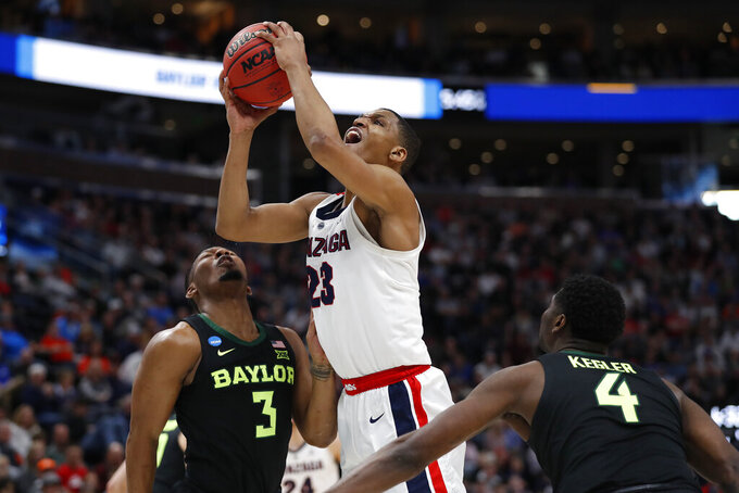 Gonzaga guard Zach Norvell Jr. (23) looks to shoot against Baylor guards King McClure (3) and guard Mario Kegler (4) during the first half of a second-round game in the NCAA men's college basketball tournament Saturday, March 23, 2019, in Salt Lake City. (AP Photo/Jeff Swinger)