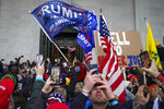 FILE - In this Jan. 6, 2021, file photo, Trump supporters gather outside the Capitol in Washington. Selena Gomez is laying much of the blame for the violent attack on the U.S. Capitol at the feet of Big Tech. The singer told the leaders of Facebook, Twitter, Google and YouTube that they've allowed