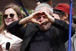 Former Brazilian President Luiz Inacio Lula da Silva flashes a hand heart during a rally at the Metal Workers Union headquarters, in Sao Bernardo, Brazil, Saturday, Nov. 9, 2019. Da Silva addressed thousands of jubilant supporters a day after being released from prison.