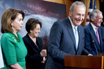 Senate Minority Leader Sen. Chuck Schumer of N.Y., accompanied by Sen. Ed Markey, D-Mass., right, Rep. Anna Eshoo, D-Calif., second from left, and House Minority Leader Nancy Pelosi of Calif., left, laugh during a news conference on Capitol Hill in Washington, Wednesday, May 16, 2018, after the Senate passes a resolution to reverse the FCC decision to end net neutrality. (AP Photo/Andrew Harnik)