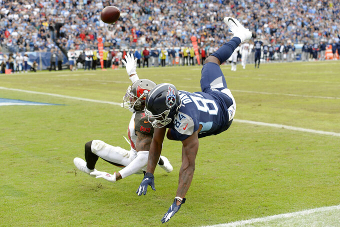 Tampa Bay Buccaneers cornerback Carlton Davis (33) breaks up a pass intended for Tennessee Titans wide receiver Corey Davis (84) in the second half of an NFL football game Sunday, Oct. 27, 2019, in Nashville, Tenn. (AP Photo/Mark Zaleski)