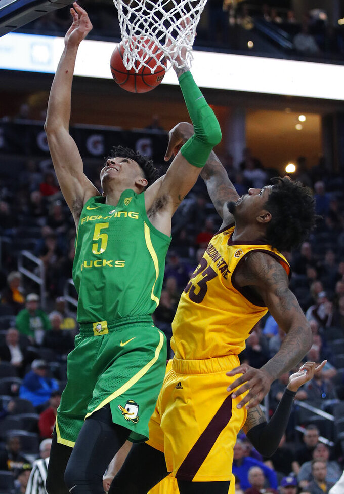 Arizona State's Romello White, right, fouls Oregon's Miles Norris during the second half of an NCAA college basketball game in the semifinals of the Pac-12 men's tournament Friday, March 15, 2019, in Las Vegas. (AP Photo/John Locher)