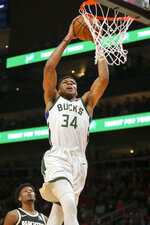 Milwaukee Bucks forward Giannis Antetokounmpo (34) dunks against the Atlanta Hawks in the first half of an NBA basketball game, Wednesday, Nov. 20, 2019, in Atlanta. (AP Photo/Brett Davis)