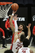 Utah forward Timmy Allen, back, shoots over Washington State forward Andrej Jakimovski during the second half of an NCAA college basketball game in Pullman, Wash., Thursday, Jan. 21, 2021. (AP Photo/Young Kwak)