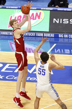 Arkansas' Connor Vanover, left, takes a three point shot while guarded by Kentucky's Lance Ware (55) during the first half of an NCAA college basketball game in Lexington, Ky., Tuesday, Feb. 9, 2021. (AP Photo/James Crisp)