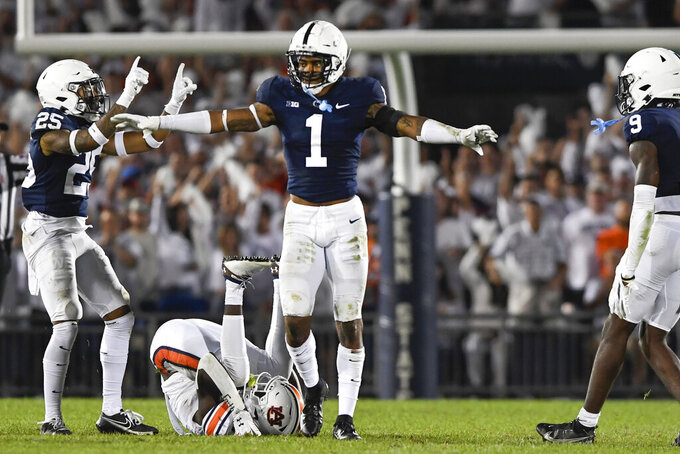 FILE - Penn State safety Jaquan Brisker (1) and cornerback Daequan Hardy (25) celebrate an incomplete pass against Auburn during an NCAA college football game in State College, Pa., in this Saturday, Sept. 18, 2021, file photo. Brisker was selected to The Associated Press Midseason All-America team, announced Tuesday, Oct. 19, 2021. (AP Photo/Barry Reeger, File)