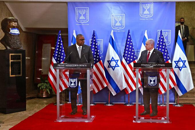 U.S. Defense Secretary Lloyd Austin, left, and Israeli Prime Minister Benjamin Netanyahu give statements after their meeting, at the prime minister's office, in Jerusalem, Monday, April 12, 2021. (Menahem Kahana/Pool via AP)