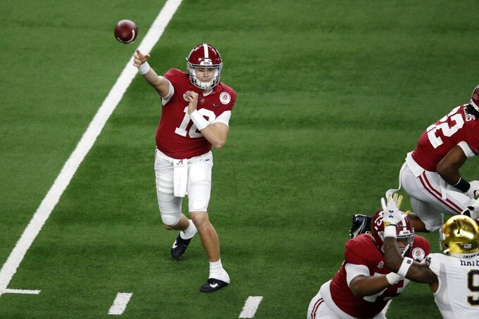 Alabama quarterback Mac Jones (10) throws a pass from the pocket in the first half of the Rose Bowl NCAA college football game against Notre Dame in Arlington, Texas, Friday, Jan. 1, 2021. (AP Photo/Roger Steinman)