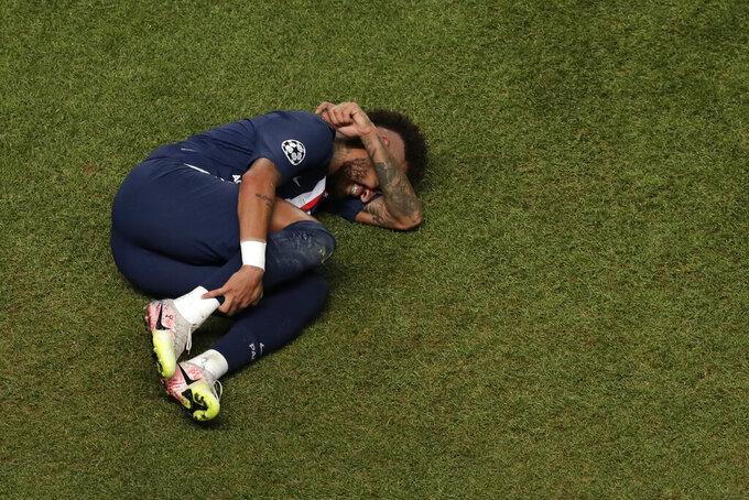 PSG's Neymar lies on the ground during the Champions League final soccer match between Paris Saint-Germain and Bayern Munich at the Luz stadium in Lisbon, Portugal, Sunday, Aug. 23, 2020. (AP Photo/Manu Fernandez, Pool)