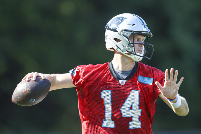 Carolina Panthers quarterback Sam Darnold throws during practice at the NFL football team's training camp in Spartanburg, S.C., Wednesday, July 28, 2021. (AP Photo/Nell Redmond)