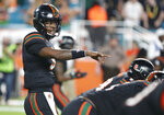 Miami quarterback N'Kosi Perry calls a play during the first half of the team's NCAA college football game against North Carolina, Thursday, Sept. 27, 2018, in Miami Gardens, Fla. Perry completed eight of 12 passes for 125 yards with one touchdown and one interception in his debut as the Miami starter. Miami defeated North Carolina 47-10. (AP Photo/Wilfredo Lee)