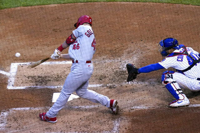 St. Louis Cardinals' Paul Goldschmidt, left, hits a three-run home run against the Chicago Cubs during the third inning of a baseball game in Chicago, Sunday, Sept. 6, 2020. (AP Photo/Nam Y. Huh)