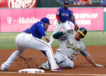 Oakland Athletics third baseman Matt Chapman is tagged out at third by Texas Rangers' Asdrubal Cabrera as Chapman was trying to advance to the bag on a single by Matt Olson in the first inning of a baseball game in Arlington, Texas, Friday, June 7, 2019. (AP Photo/Tony Gutierrez)