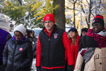 Chicago Teachers Union and Service Employees International Union members walk to Richard Yates Elementary School together after a teachers strike that lasted more than two weeks, Friday morning, Nov. 1, 2019. (Pat Nabong/Chicago Sun-Times via AP)