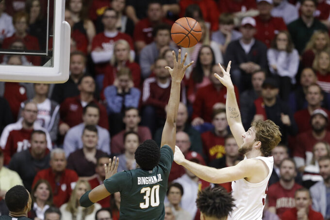 Indiana's Joey Brunk (50) shoots over Michigan State's Marcus Bingham Jr. (30) during the second half of an NCAA college basketball game, Thursday, Jan. 23, 2020, in Bloomington, Ind. (AP Photo/Darron Cummings)