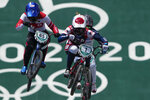 Alise Willoughby of the United States, center, and Sae Hatakeyama of Japan, left, compete in the women's BMX Racing quarterfinals at the 2020 Summer Olympics, Thursday, July 29, 2021, in Tokyo, Japan. (AP Photo/Ben Curtis)