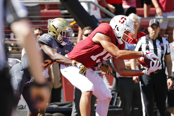 Stanford wide receiver JJ Arcega-Whiteside (19) catches a touchdown pass over UC Davis defensive back Vincent White (20) in the first half in an NCAA college football game in Stanford, Calif., Saturday, Sept. 15, 2018. (AP Photo/Jim Gensheimer)