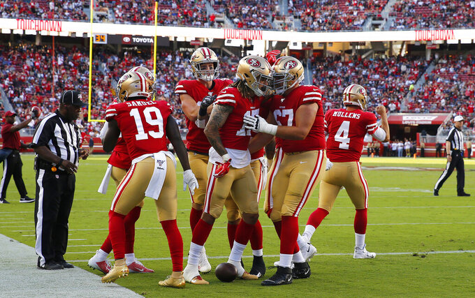 San Francisco 49ers wide receiver Jalen Hurd, center, celebrates with teammates after scoring against the Dallas Cowboys during the first half of an NFL preseason football game in Santa Clara, Calif., Saturday, Aug. 10, 2019. (AP Photo/John Hefti)