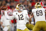 Notre Dame quarterback Ian Book (12) works in the pocket against Georgia during the first half of an NCAA college football game, Saturday, Sept. 21, 2019, in Athens, Ga. (AP Photo/John Bazemore)