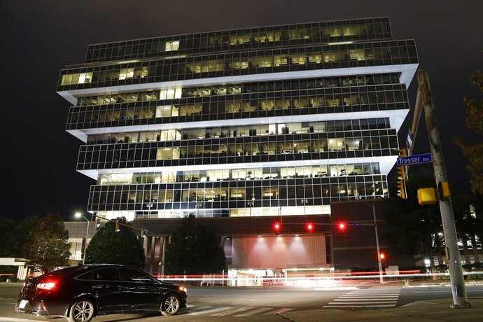 Cars pass Purdue Pharma headquarters Thursday, Sept. 12, 2019, in Stamford, Conn. For months, the judge overseeing national litigation over the opioids crisis urged all sides to reach a settlement that could end thousands of lawsuits filed by state and local governments. But the chaotic developments this week in the case against OxyContin maker Purdue Pharma underscore how difficult that goal is. (AP Photo/Frank Franklin II)