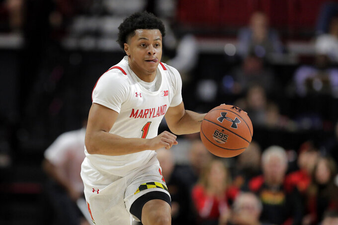 Maryland guard Anthony Cowan Jr. drives against Holy Cross during the first half of an NCAA college basketball game, Tuesday, Nov. 5, 2019, in College Park, Md. (AP Photo/Julio Cortez)