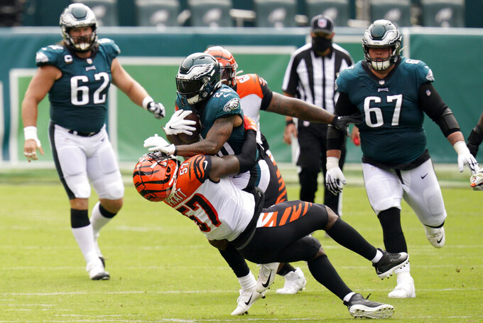 Philadelphia Eagles' Miles Sanders (26) collides with Cincinnati Bengals' Germaine Pratt (57) during the first half of an NFL football game, Sunday, Sept. 27, 2020, in Philadelphia. (AP Photo/Chris Szagola)