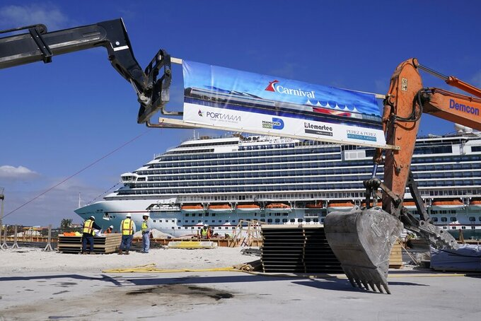 n this Friday, Jan. 29, 2021 photo, The Carnival Dream cruise ship arrives as construction work is underway for Carnival Cruise Line's new Terminal F, which will be the homeport to the Carnival Celebration cruise ship at PortMiami, in Miami. Cruise companies are adapting to a changing landscape amid a rise in COVID-19 cases that is threatening to dampen the industry's comeback.(AP Photo/Lynne Sladky)