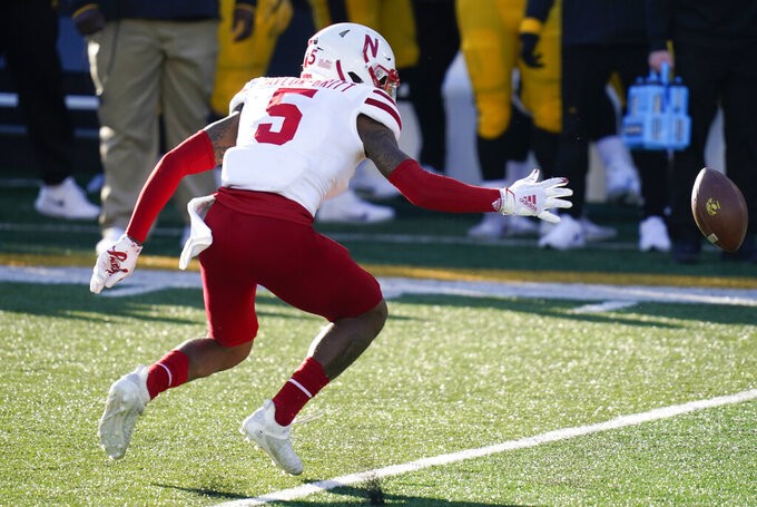Nebraska's Cam Taylor-Britt fumbles a punt during the second half of an NCAA college football game against Iowa, Friday, Nov. 27, 2020, in Iowa City, Iowa. Iowa recovered the fumble. Iowa won 26-20. (AP Photo/Charlie Neibergall)
