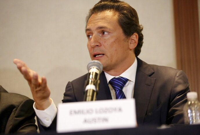 FILE - In this Aug. 17, 2017 file photo, Emilio Lozoya, former head of Mexico's state-owned oil company Pemex, gives a press conference in Mexico City. On Feb 2020, Spanish police arrested Lozoya in southern Spain. Mexico had been pursuing Lozoya through Europe for months over allegations of an illegal contract while he was at Pemex. (AP Photo/Gustavo Martinez Contreras, File)