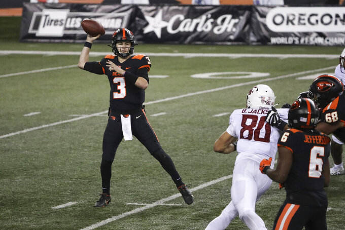 Oregon State quarterback Tristan Gebbia looks for an open teammate during the second half of an NCAA college football game against Washington State in Corvallis, Ore., Saturday, Nov. 7, 2020. Washington State won 38-28. (AP Photo/Amanda Loman)