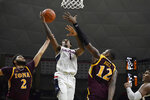 Connecticut's Christian Vital, center, shoots as Iona's E.J. Crawford, left, and Iona's Tajuan Agee, right, defend, in the second half of an NCAA college basketball game, Wednesday, Dec. 4, 2019, in Storrs, Conn. (AP Photo/Jessica Hill)