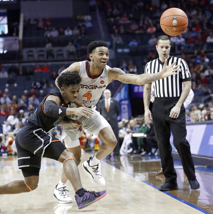 Virginia Tech's Nickeil Alexander-Walker (4) and Miami's Chris Lykes chase a loose ball during the first half of an NCAA college basketball game in the Atlantic Coast Conference tournament in Charlotte, N.C., Wednesday, March 13, 2019. (AP Photo/Nell Redmond)
