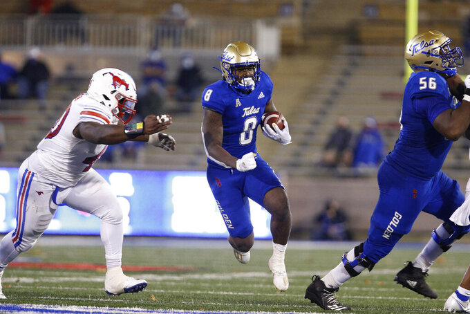 Tulsa running back Deneric Prince (8) dashes past SMU defensive tackle Elijah Chatman (40) during the second half of an NCAA college football game in Tulsa, Okla., Saturday, Nov. 14, 2020. (AP Photo/Joey Johnson)