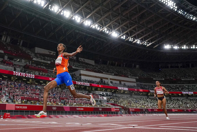 Sifan Hassan, of the Netherlands, wins the women's 10,000-meter run final at the 2020 Summer Olympics, Saturday, Aug. 7, 2021, in Tokyo. (AP Photo/David J. Phillip)