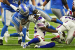 Detroit Lions running back Jamaal Williams (30) is tackled by Buffalo Bills defensive back Jaquan Johnson (46) during the first half of a preseason NFL football game, Friday, Aug. 13, 2021, in Detroit. (AP Photo/Paul Sancya)