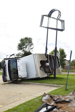 A furniture delivery truck was thrown into a sign pole on 41st Ave. due to a tornado, Wednesday, Sept. 11, 2019, in Sioux Falls, S.D. A storm carrying three tornadoes struck South Dakota's largest city overnight, leaving a trail of destroyed buildings and downing power lines. (Erin Bormett/The Argus Leader via AP)