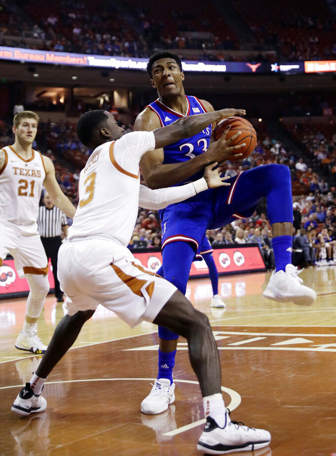Osetkowski, defense lead Texas past No. 11 Kansas 73-63