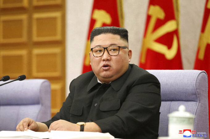 """In this photo taken during a four-day meeting held from Feb. 8, 2021 until Feb. 11, 2021 and provided by the North Korean government, North Korean leader Kim Jong Un attends at a meeting of Central Committee of Worker's Party of Korea in Pyongyang, North Korean. Independent journalists were not given access to cover the event depicted in this image distributed by the North Korean government. The content of this image is as provided and cannot be independently verified. Korean language watermark on image as provided by source reads: """"KCNA"""" which is the abbreviation for Korean Central News Agency. (Korean Central News Agency/Korea News Service via AP)"""