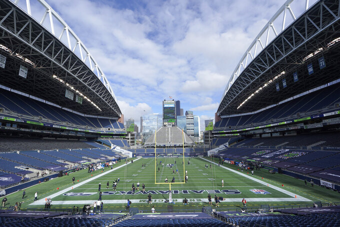 CenturyLink Field is shown as the Seattle Seahawks and the Dallas Cowboys warm up before an NFL football game, Sunday, Sept. 27, 2020, in Seattle. (AP Photo/Elaine Thompson)