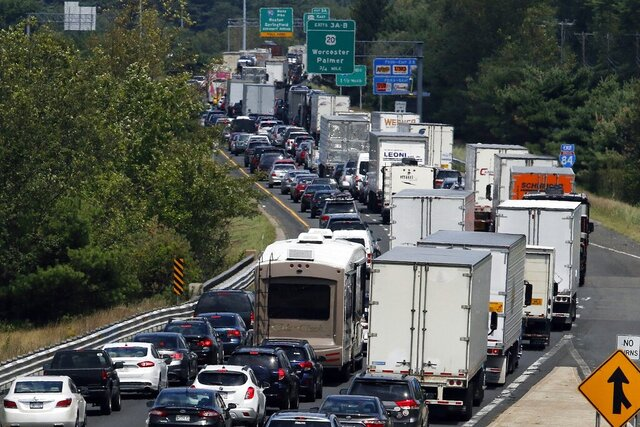 FILE - In this Aug. 12, 2016, file photo, traffic crawls eastbound on Interstate 84 in Sturbridge, Mass., after an overnight accident involving two tractor-trailers on the Massachusetts Turnpike. An alliance of Northeast and mid-Atlantic states are working on a pact aimed at lowering carbon emissions from cars, trucks and other means of transportation. A draft version of the agreement, known as the Transportation and Climate Initiative, was released Tuesday, Dec. 17, 2019. (AP Photo/Bill Sikes, File)
