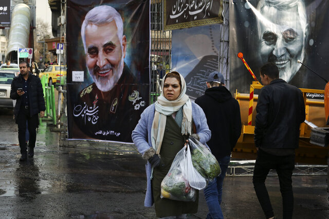 Pedestrians walk past banners of Iranian Revolutionary Guard Gen. Qassem Soleimani, who was killed in Iraq in a U.S. drone attack on Friday, in Tajrish square in northern Tehran, Iran, Thursday, Jan. 9, 2020. Many Iranians say they are relieved that neither their country nor the United States appear primed right now for a more direct military confrontation that could lead to war. (AP Photo/Vahid Salemi)