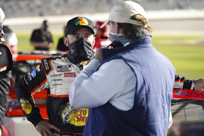 Austin Dillon, left, talks with car owner Richard Childress on pit road before the start of the second of two qualifying NASCAR auto races for the Daytona 500 at Daytona International Speedway, Thursday, Feb. 11, 2021, in Daytona Beach, Fla. (AP Photo/John Raoux)